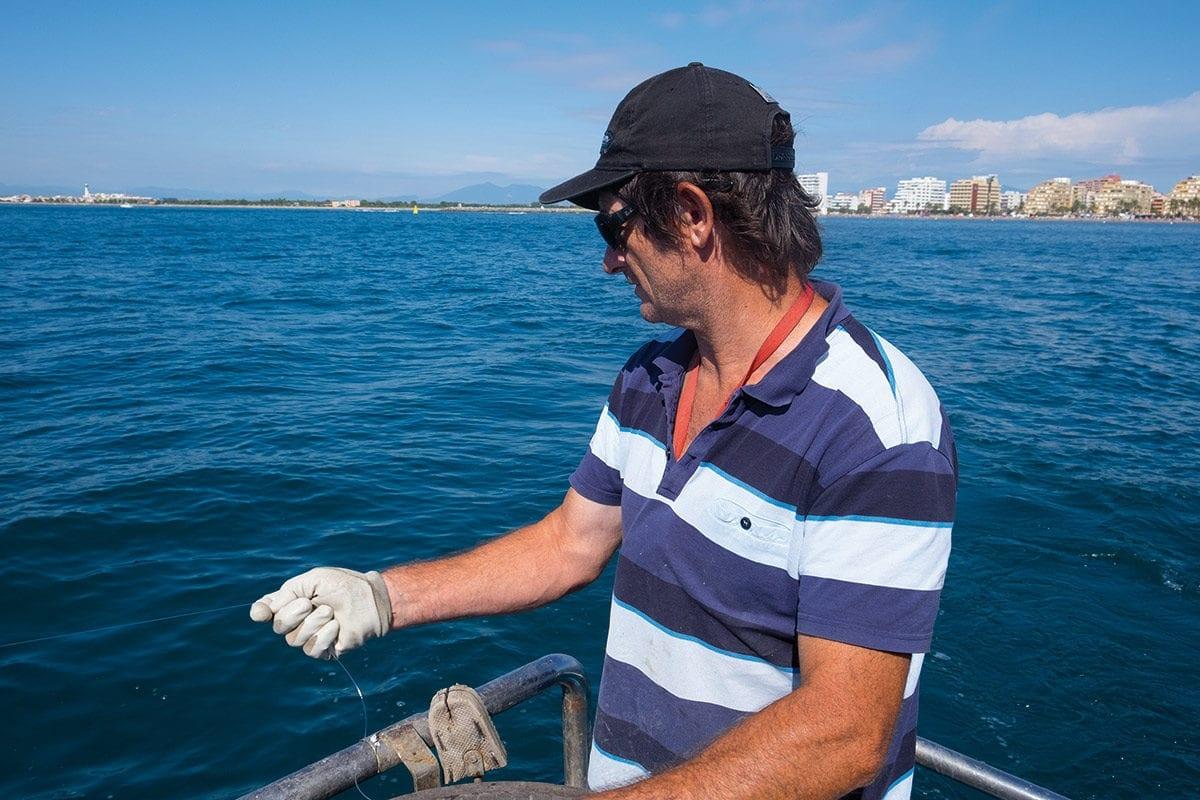 Fischer auf seinem Fischerboot